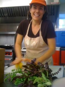 Nancy making peperonata in the kitchen