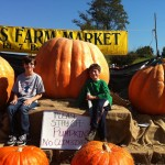 Be creative!  You don't have to grow a huge pumpkin yourself to spearhead an annual Pumpkin Pageant for kids at your local market.