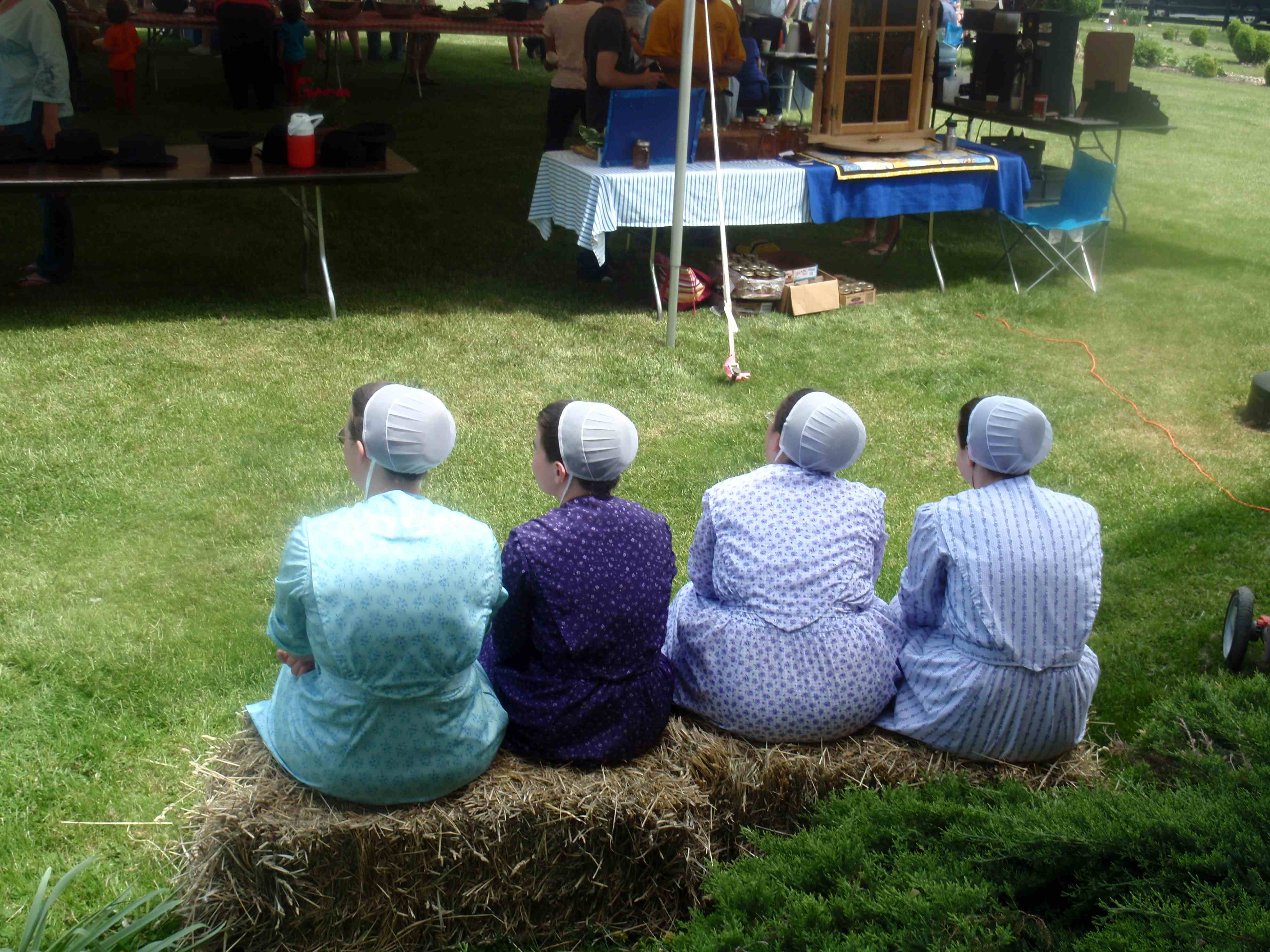 After a long day, have a seat on a hay bale, and take a load off!  Here, some of my butcher's family (we invite our butcher each year to interact with our customers) enjoys the perfect end to a perfect day.