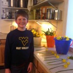 My nephew picked daffodils this spring, bundled them, and sold them himself at farmers market.  Not bad for a nine year old.  That smile is NOT faked!