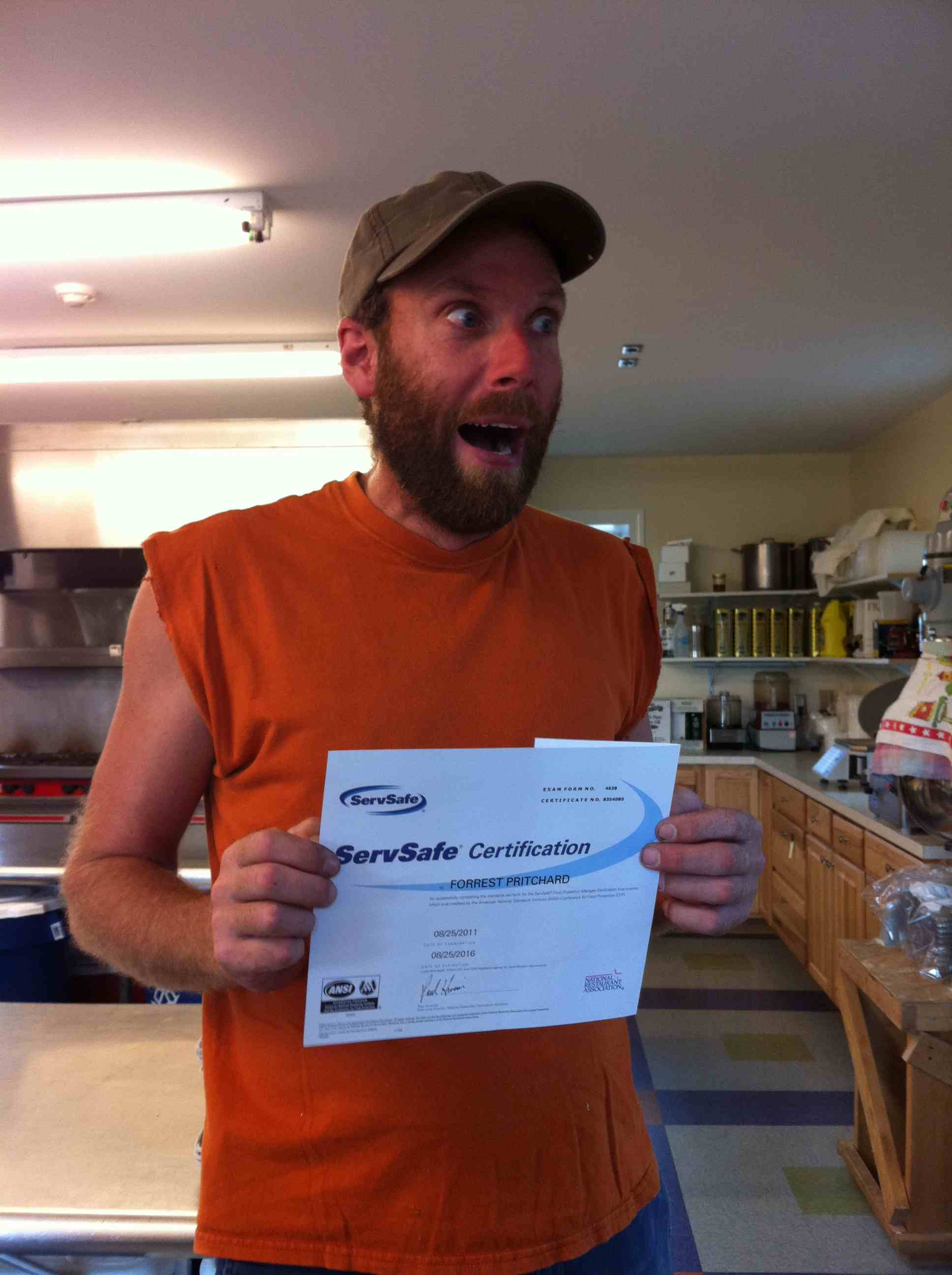 Me, super excited to receive my required Serve Safe certificate.  I spent an entire day of my life sitting in class, learning how to wash utensils, stack food boxes, and rotate inventory for this.  I got a 96 on the exam.  Does this picture make YOU feel safer?