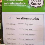 A white board listing the names of local farms in the produce section.  It might not be the same as talking to your local farmer at their market booth, but hey... it's an improvement.