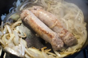 Smith Meadows sausages sauteing with onions