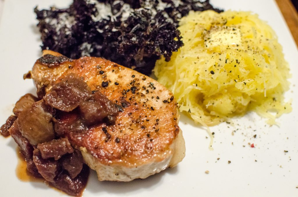 Pasture-raised boneless pork chops served with kale and spaghetti squash