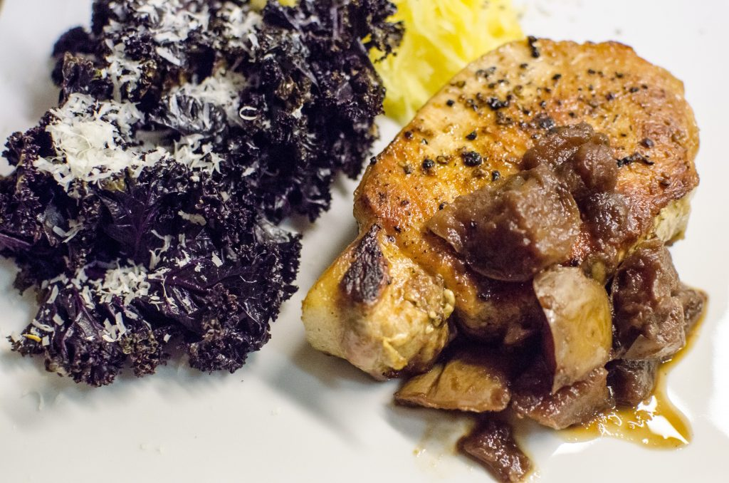 Purple kale and thick-cut pork chop with apple dressing